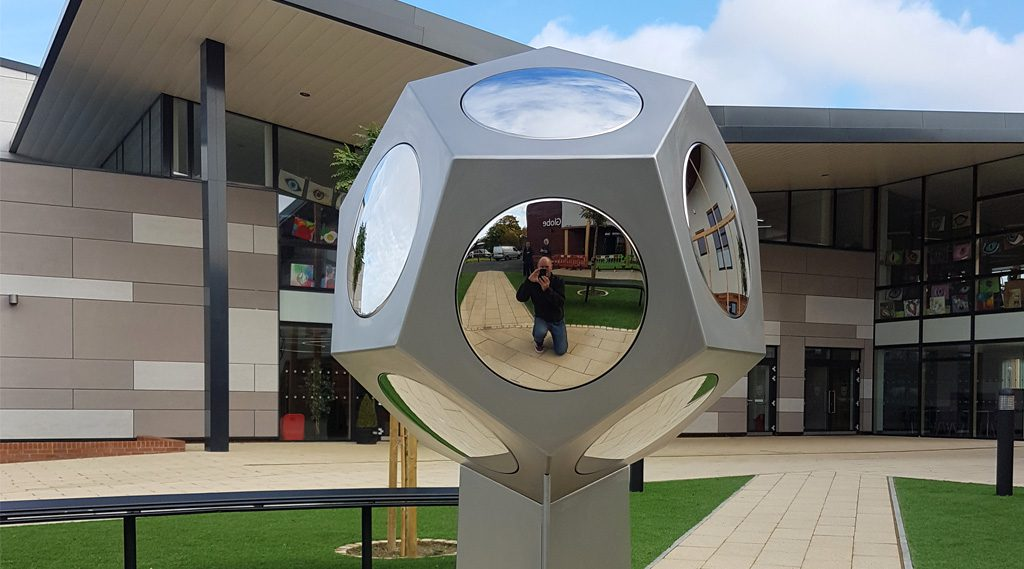 Globe Sculpture in Stainless Steel. Weydon School, Farnham Suffolk
